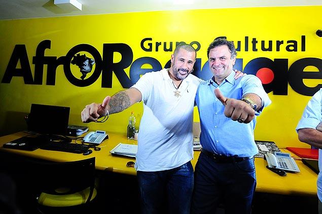 Ao lado de José Júnior, Aécio visita sede do AfroReggae, no Rio