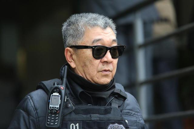Policial federal Newton Ishii, durante uma das ações da Operação Lava-Jato Foto: GIULIANO GOMES / ESTADÃO CONTEÚDO